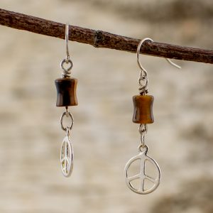 Tigers Eye Peace Earrings on a branch