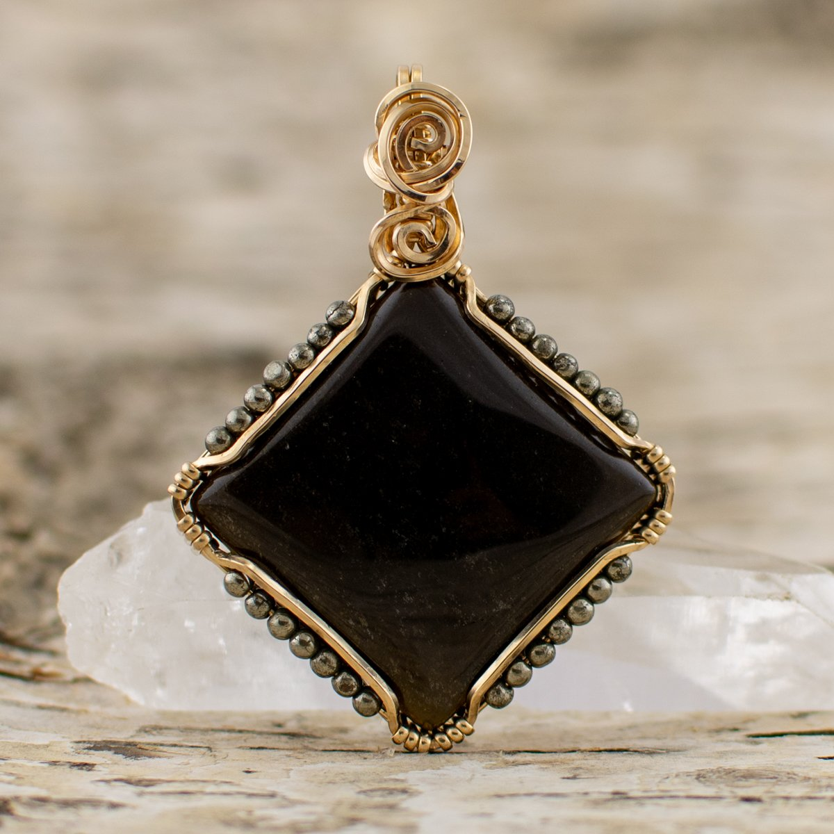 The Shield Golden Sheen Obsidian Pendant black and sparkly
