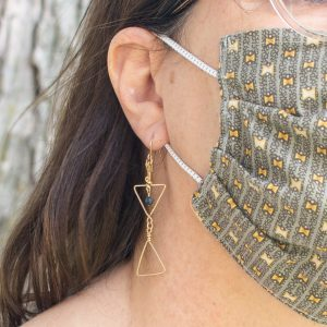 14k gold filled earrings on woman with mask