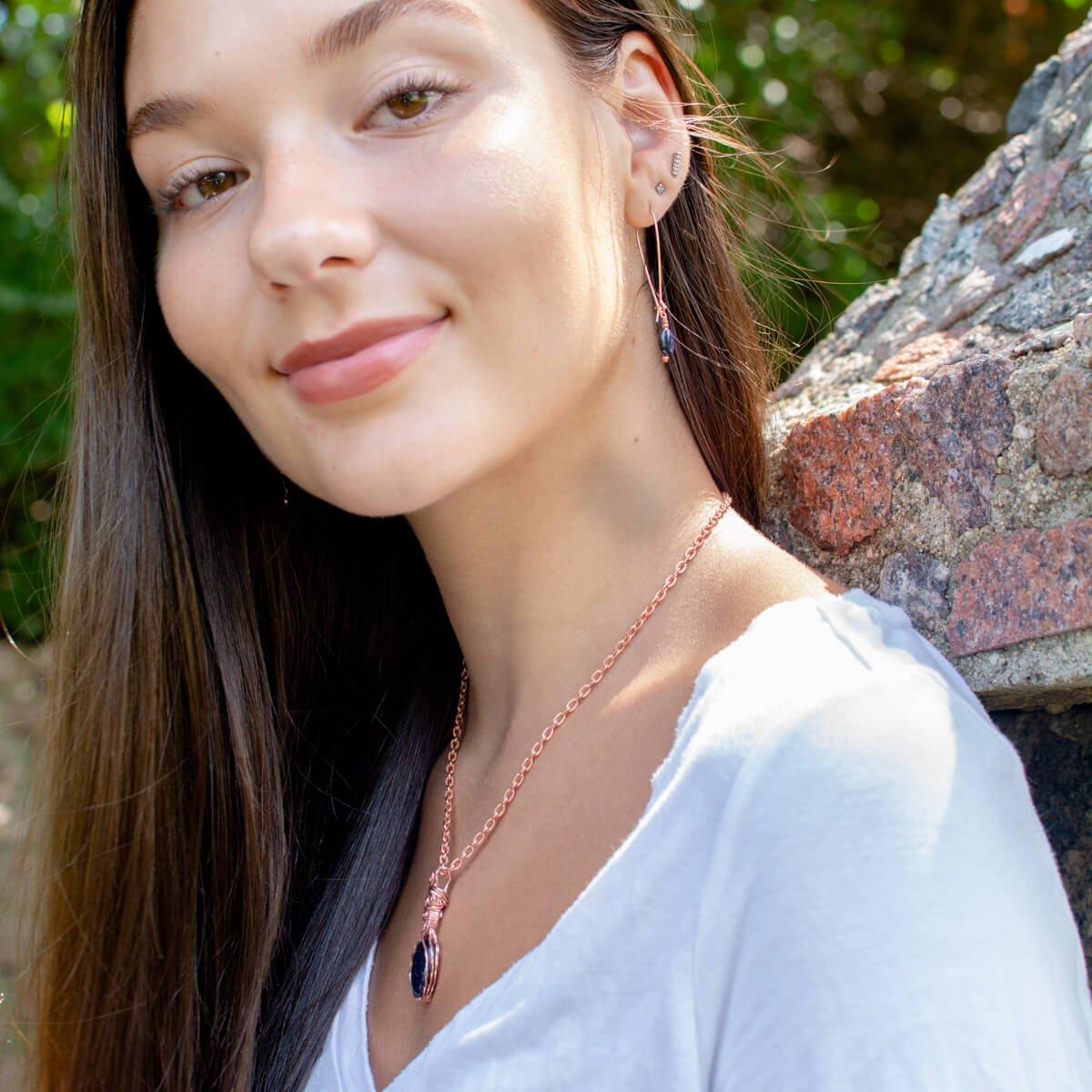 Lady Wearing Blue Goldstone Pendant and Earrings